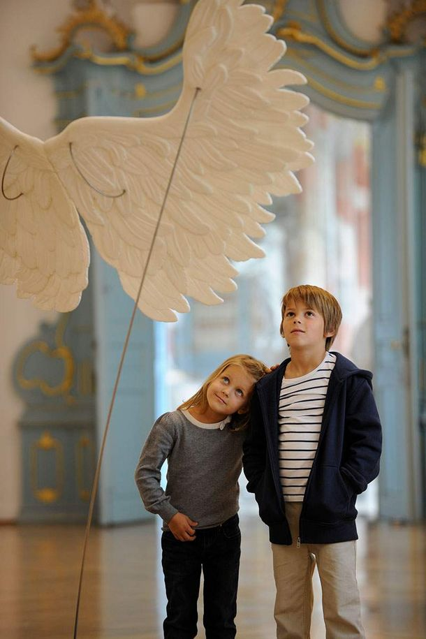 Schussenried monastery, children looking at angels' wings in the exhibition